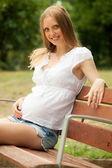 Long-haired pregnancy woman — Zdjęcie stockowe