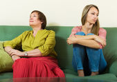 Sad young woman and  mature mother — Stock Photo