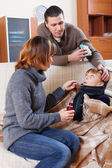 Parents giving  medicament to unwell  son — Stock Photo
