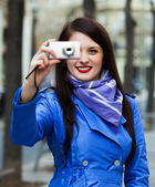 Young woman with photocamera — Stock Photo