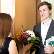 Man giving gifts to woman — Stock Photo #48990445