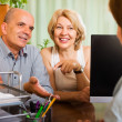 Happy pensioners talking with manager — Stock Photo #48991005