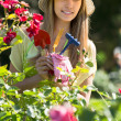 Female florist working in garden — Stock Photo