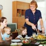 Multigeneration family communicate over  table — Stock Photo #48991615
