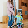Mother with child doing home cleaning — Stock Photo
