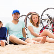 Parents with kid on beach — Stock Photo #48991861