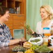 Two mature women with  herbs — Stock Photo #48993777