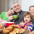 Family drinks tea — Stock Photo #48994655