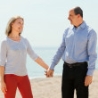 Elderly man and woman holding hands — Stock Photo #48994941