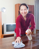 Woman cleaning the table — Stock Photo