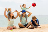 Positive family playing at beach — Stok fotoğraf