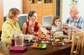 Happy family at celebratory table — Stock Photo