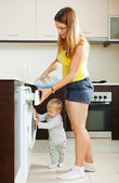 Family using washing machine  — Stock Photo