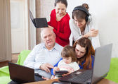 Family uses  various electronic devices — Stock Photo