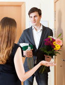 Young man giving gifts — Stock Photo