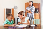 Ordinary family doing homework — Stock Photo
