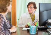 Doctor inserting information about patient — Stock Photo