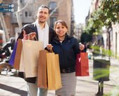 Ouple in jackets with purchases   — Stock Photo