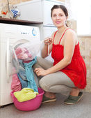 Housewife with laundry bag — Stock Photo