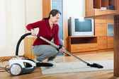 Mature woman with vacuum cleaner — Foto Stock