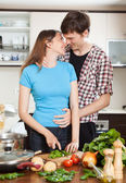Loving couple hugging in kitchen — Stock Photo