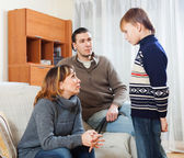 Mother and father scolding teenager son   — Stock Photo