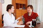 Doctor prescribing medication to  woman — Stock Photo