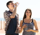 Travelers drinking cold water — Foto de Stock