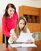 Serious women with financial documents  — Stock Photo