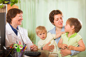 Doctor examining children — Stock Photo