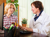 Mature doctor consulting female patient — Stock Photo