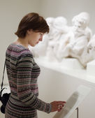 Woman looking ancient sculptures  — Stock Photo