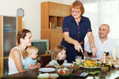 Multigeneration family communicate over  table — Stock Photo