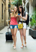 Two young girls with baggage — Stock Photo