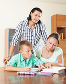 Couple with teenager son doing homework — Stok fotoğraf