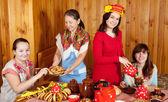 Women  drinks tea and eats pancakes — Stock Photo