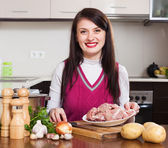 Happy  woman cooking with meat   — Stock Photo