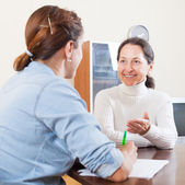 Happy senior woman answer questions   — Stock Photo