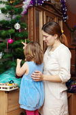 Mother and baby preparing for Christmas — Stock Photo