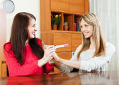 Happy girls with pregnancy test — Stock Photo
