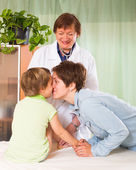 Doctor examining child — Stock Photo
