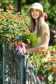 Girl in apron gardening — Stock Photo