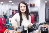 Smiling buyer at clothing store — Stock Photo