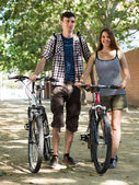 Young couple with bicycles  — Foto de Stock