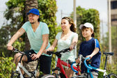 Tourists with son riding bicycles — Stock Photo