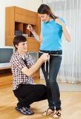 Guy measuring  thigh of girlfriend   — Stock Photo