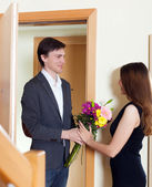 Man giving flowers to woman — Stock Photo