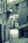 Narrow street of old Catalan village — Stock Photo