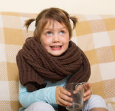 Smiling child dressed in warm  scarf  — Stock Photo