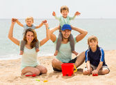 Happy family  smiling at beach — Stock Photo